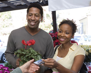 Photo - Personal Checking Accounts - Couple Buying Flowers with Debit Card