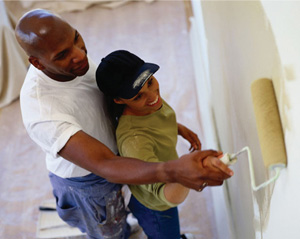 Photo - TruStage Insurance - Couple Painting Wall in Home